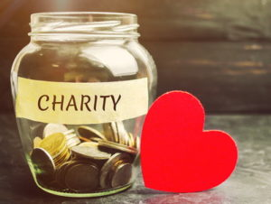 charity jar and money with heart