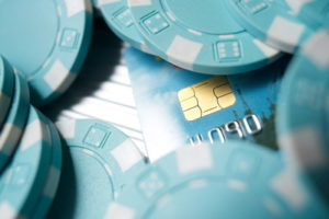 casino chips and bank card