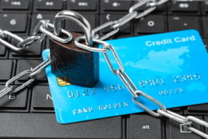credit card on a laptop with lock and chain