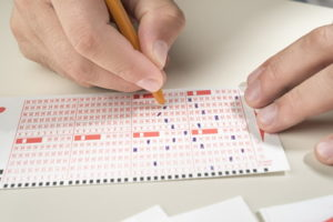 lottery card marking off numbers