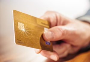 man holding payment card